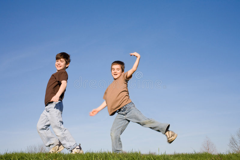 Boys Playing on a Hill royalty free stock photography