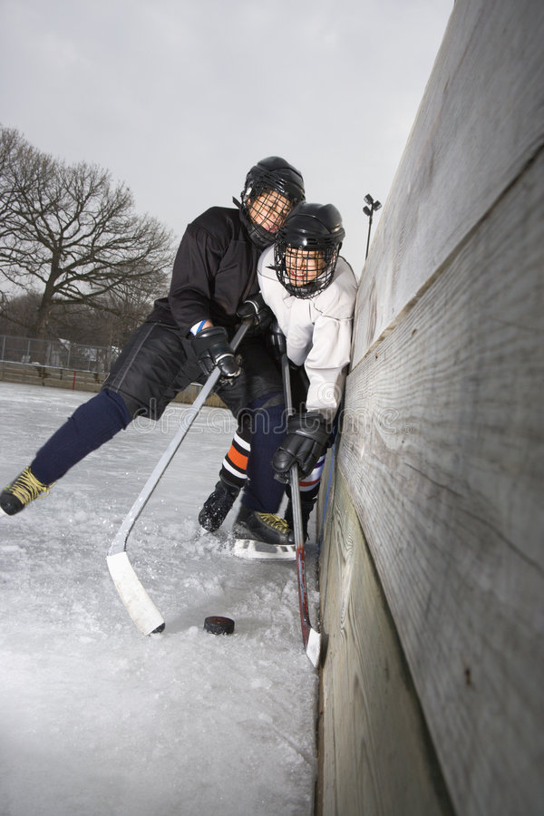 Boys playing ice hockey. royalty free stock photos