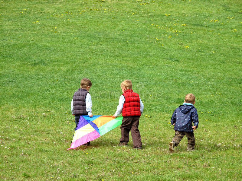 Download Boys playing with kite stock photo. Image of kites, green - 9701192