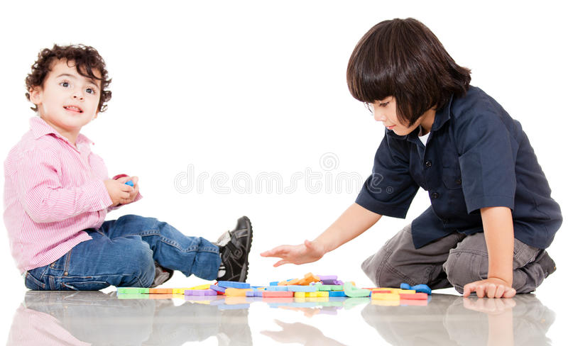 Boys playing with letters