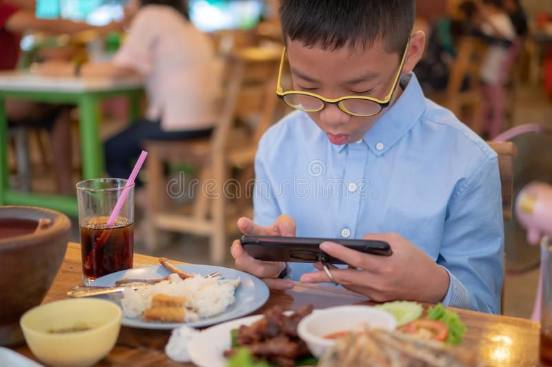 Boys are playing the phone royalty free stock images