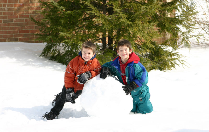 Boys Playing in the Snow stock photo