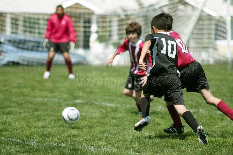 Boys Playing Soccer stock photo