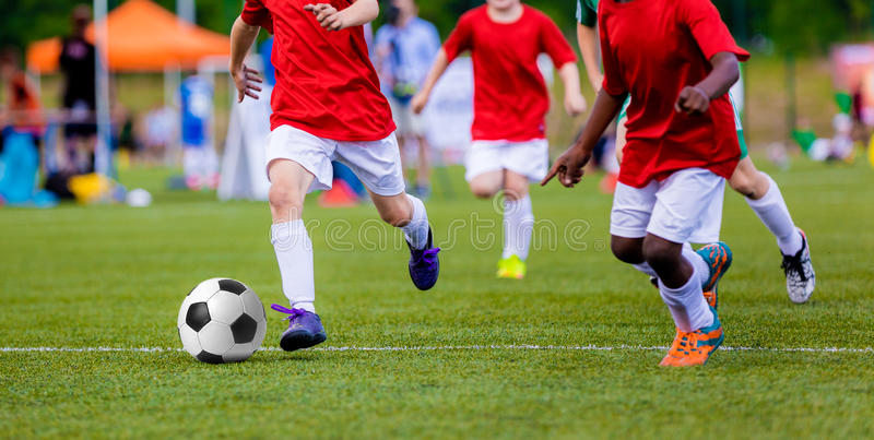 Boys playing soccer football match. International sport competition for youth soccer teams. Football tournament stock photos