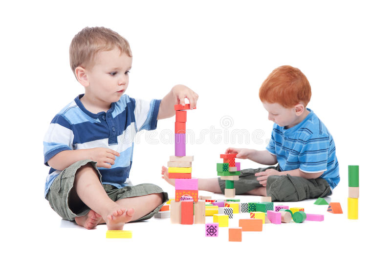 Boys Playing With Toy Blocks Stock Photos
