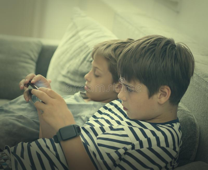 Boys playing video games stock image