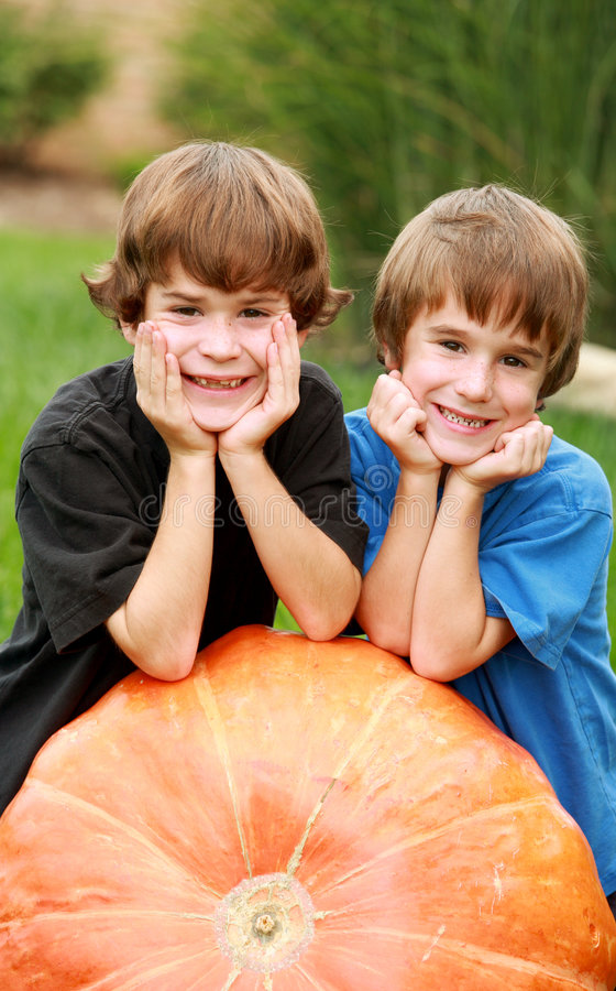 Download Boys on a Pumpkin stock image. Image of harvest, friends - 3305597