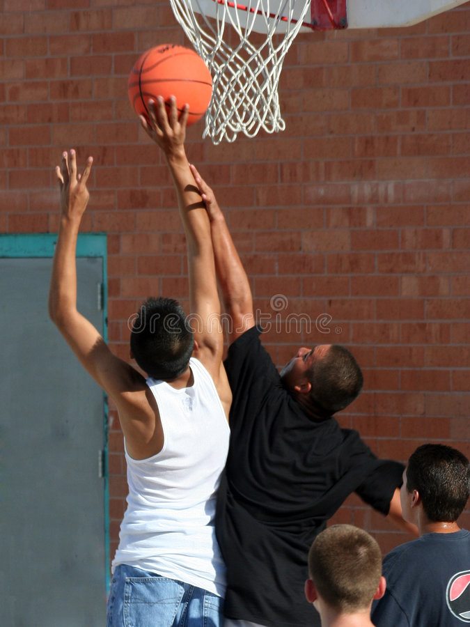 Download Boys Reaching for Basket stock image. Image of basketball - 2252509
