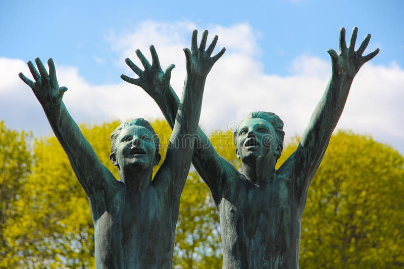 Boys reaching out. Street art in Oslo. Two statues of boys reaching out with their arms. For what can only speculated. The statues are located in a central park royalty free stock photo
