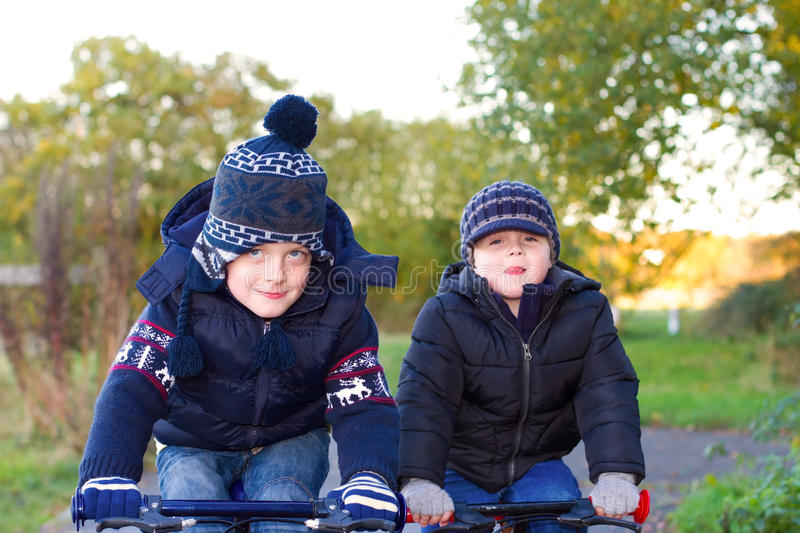 Boys riding their bikes in a country park stock photo