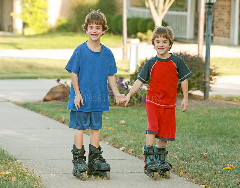 Download Boys Rollerblading stock image. Image of close, couples - 3408061