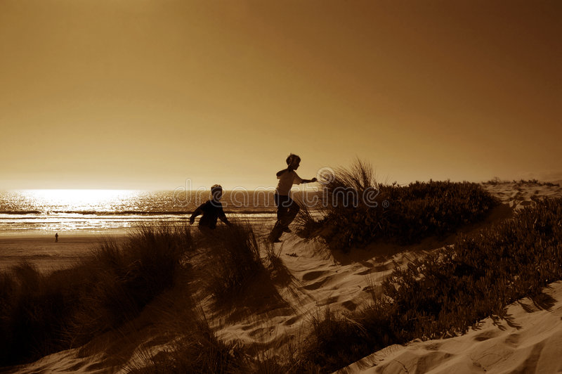 Boys Running In Dunes royalty free stock image