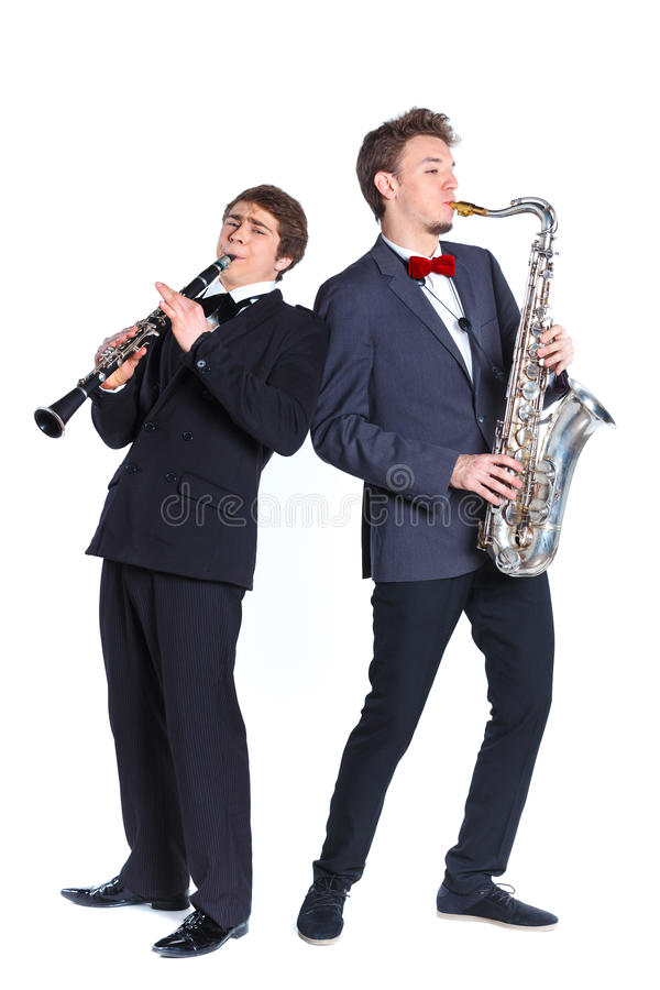 Boys with saxophone and clarinet royalty free stock image