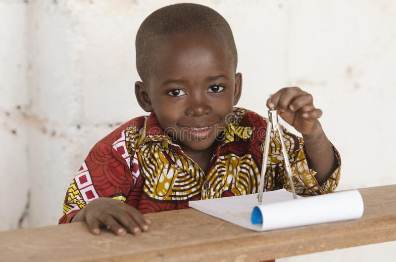 Boys in Science - Adorable African Boy Using a Compass during Ge royalty free stock image