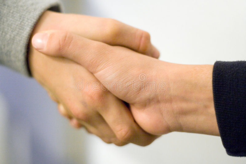 Boys Shaking Hands royalty free stock photography