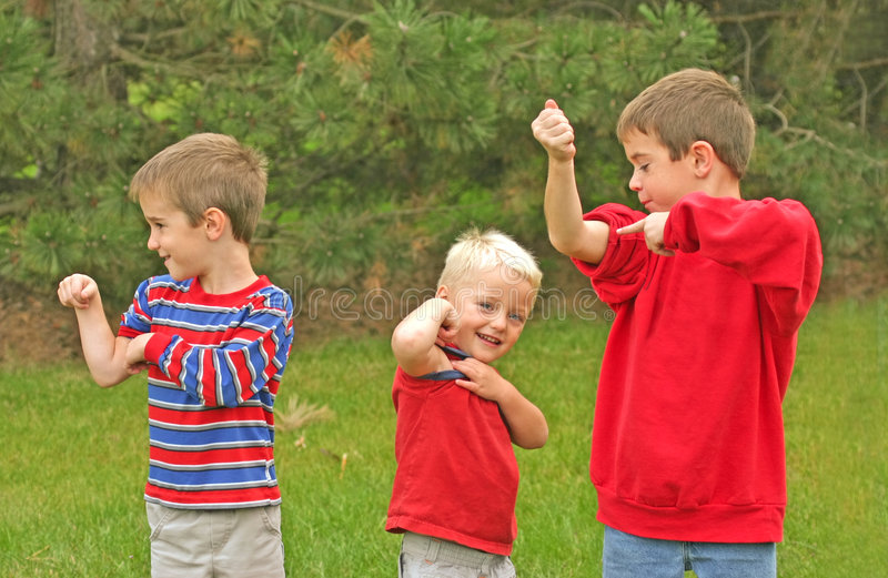 Download Boys Showing off Muscles stock photo. Image of autumn - 4433180