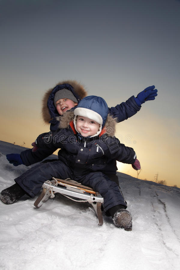 Download Boys On Sled Royalty Free Stock Images - Image: 26396539