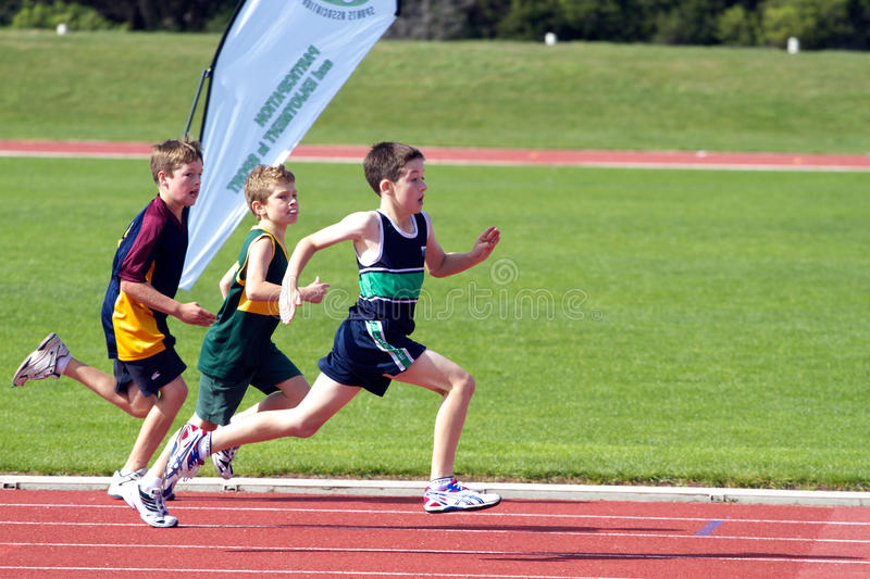 Boys in sports race stock images