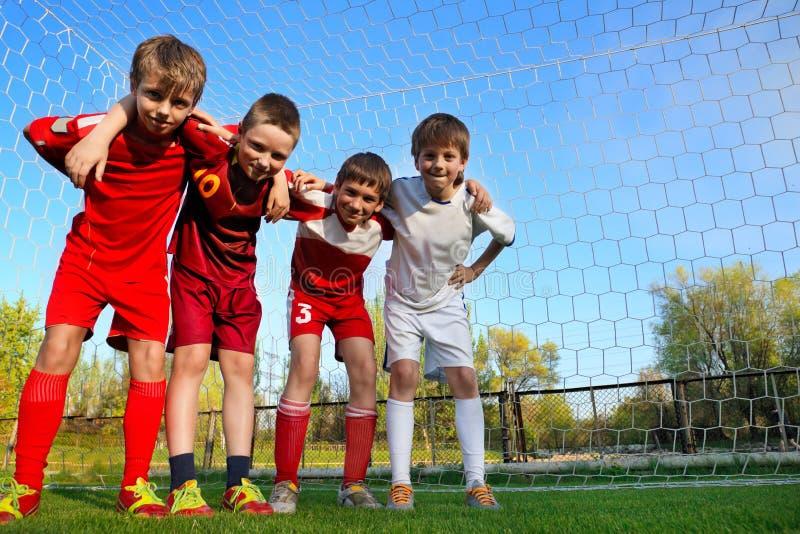 Boys stay next to goal stock photo