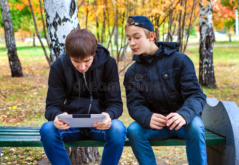 Boys with Tablet outdoor stock photography