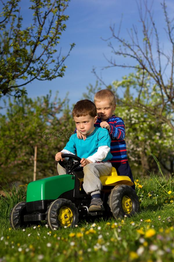 Boys and tractor. stock photo