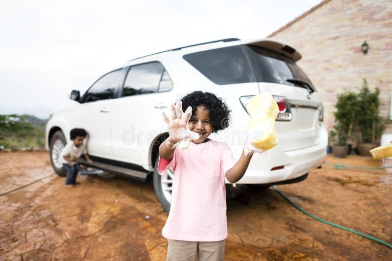 Boys washing the family car stock photo
