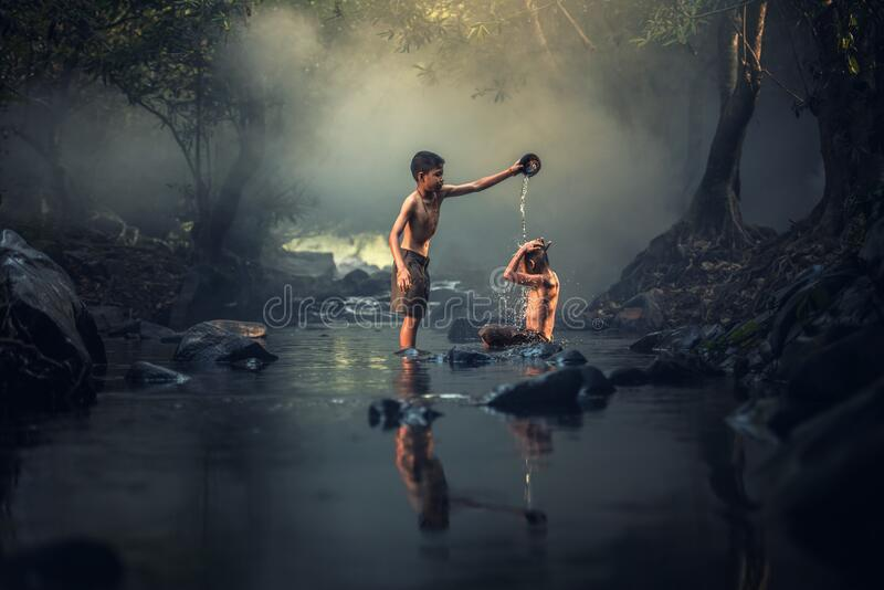 Boys washing in river royalty free stock images