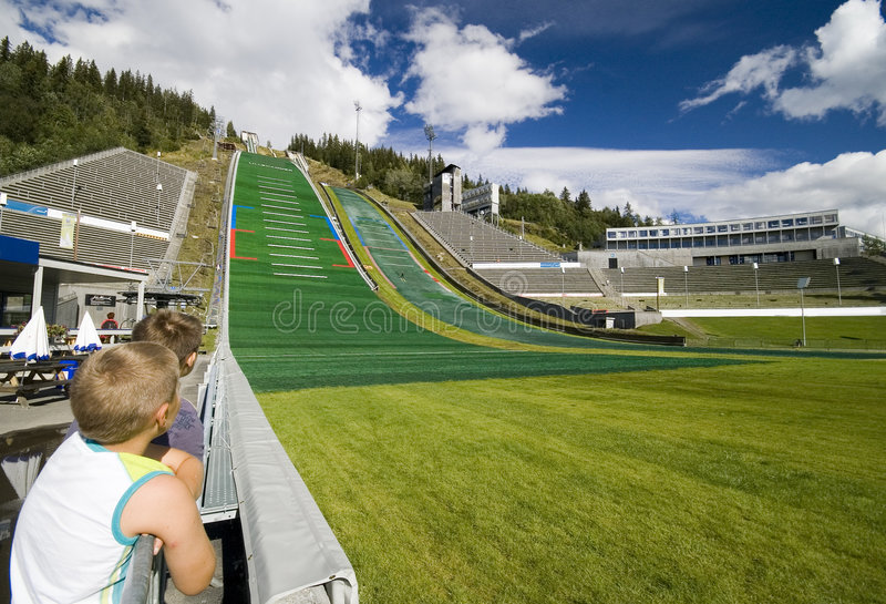 Boys watching ski jumpers. stock photo