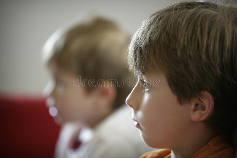 Boys watching tv stock images