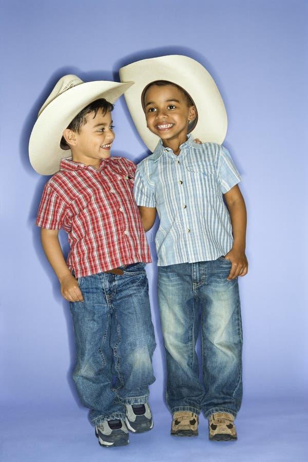 Boys wearing cowboy hats. royalty free stock photography