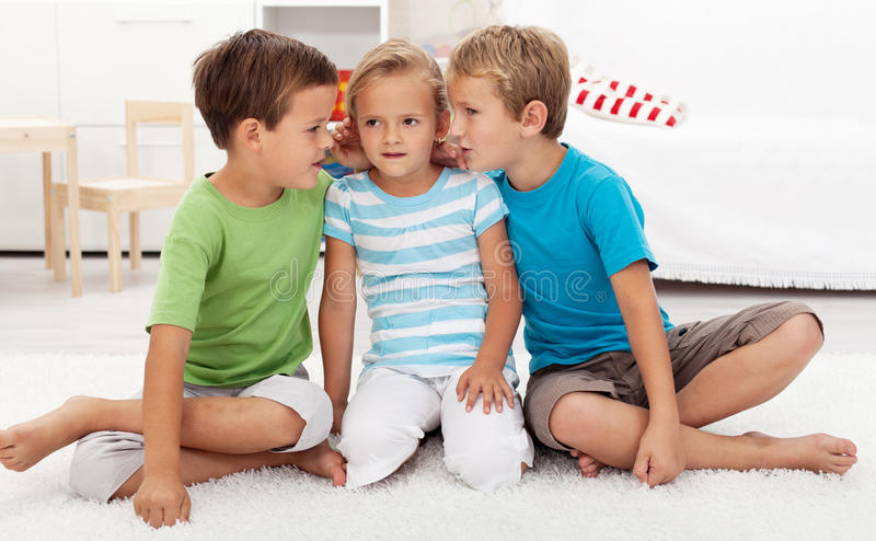 Download Boys whispering to a girl stock image. Image of news - 21045359