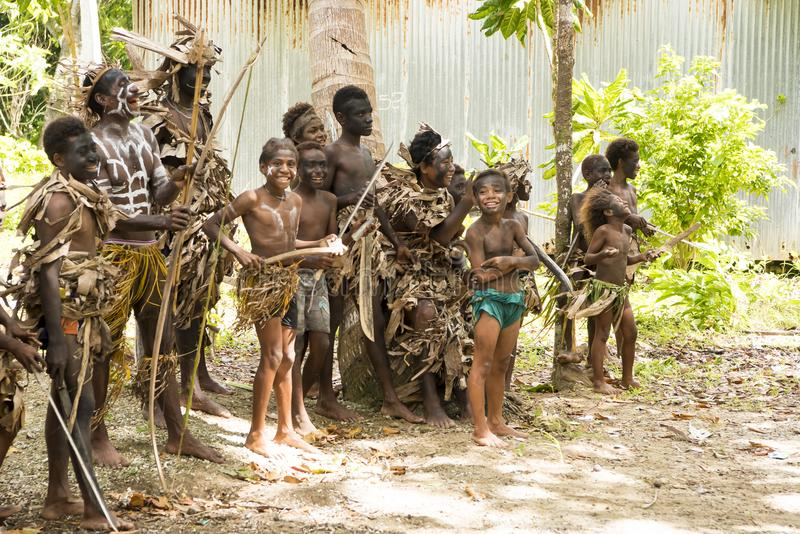 Indigenes - boys and young men - with bows, speers, Solomon Islands, South Pacific Ocean royalty free stock images