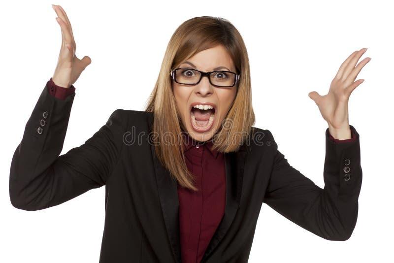 Boze bedrijfsvrouw stock foto's