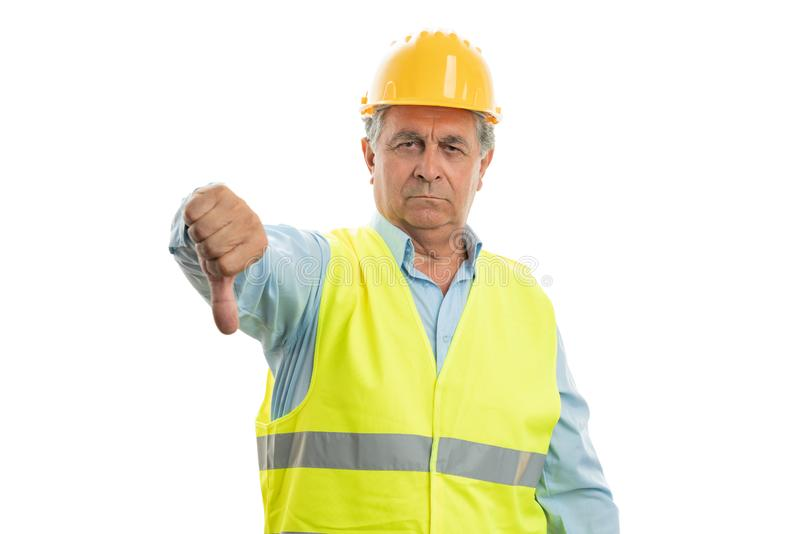 Boze bouwer die duim neer tonen stock afbeelding