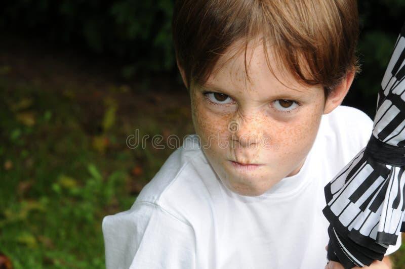 Boze jongen stock afbeeldingen