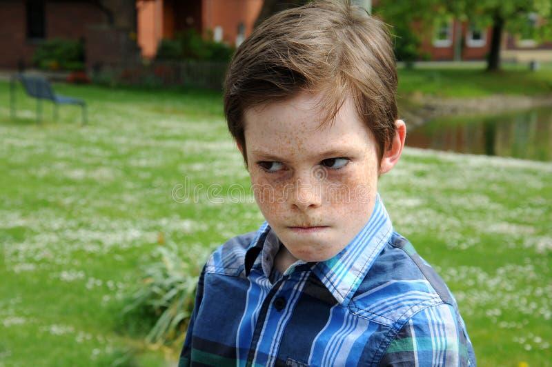 Boze jongen stock fotografie