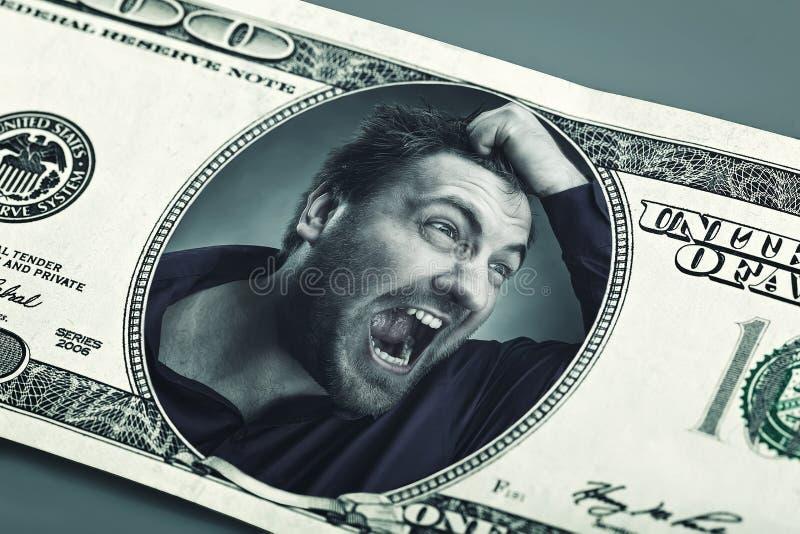 Boze mens in het dollarbankbiljet royalty-vrije stock fotografie