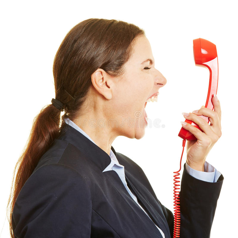 Boze onderneemster die in telefoon gillen royalty-vrije stock foto's