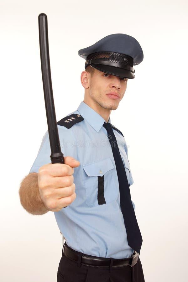 Boze politieagent met politieknuppel. royalty-vrije stock afbeelding