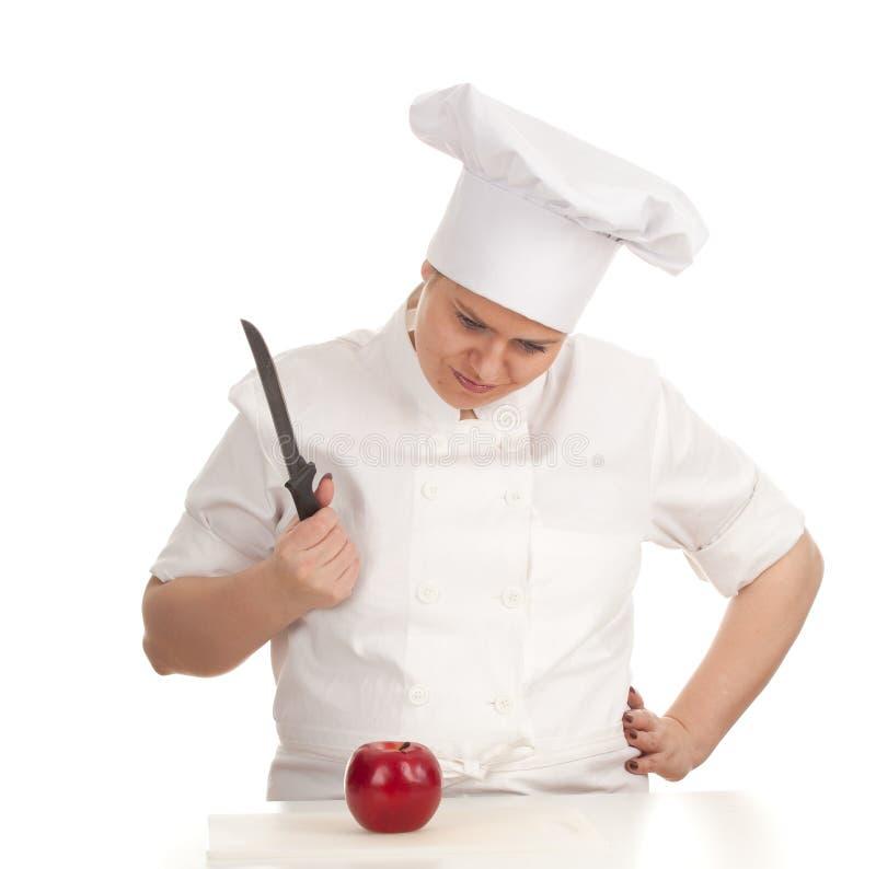 Boze vette vrouwelijke kok met rood appel en mes stock afbeeldingen