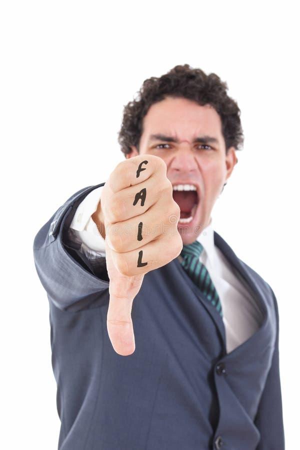 Boze zakenman die duim onderaan gebaar tonen als verwerpingssymbool royalty-vrije stock afbeeldingen