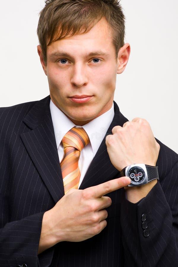 Boze zakenman die tijd toont stock afbeelding