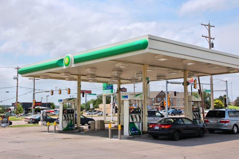 BP gas station, USA. GOODLAND, KS, USA - JUNE 25, 2013: People fill their tanks at BP gas station in Goodland, Kansas, USA. BP had 31.3 billion USD operating royalty free stock image