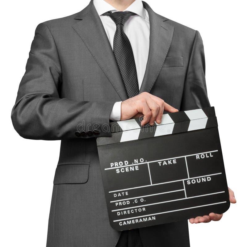 Bräde för clapper för dräkt för man bärande hållande royaltyfri foto