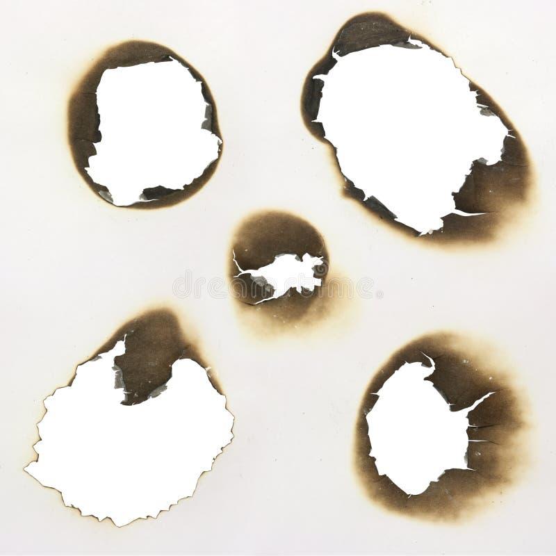 brända hål royaltyfria foton