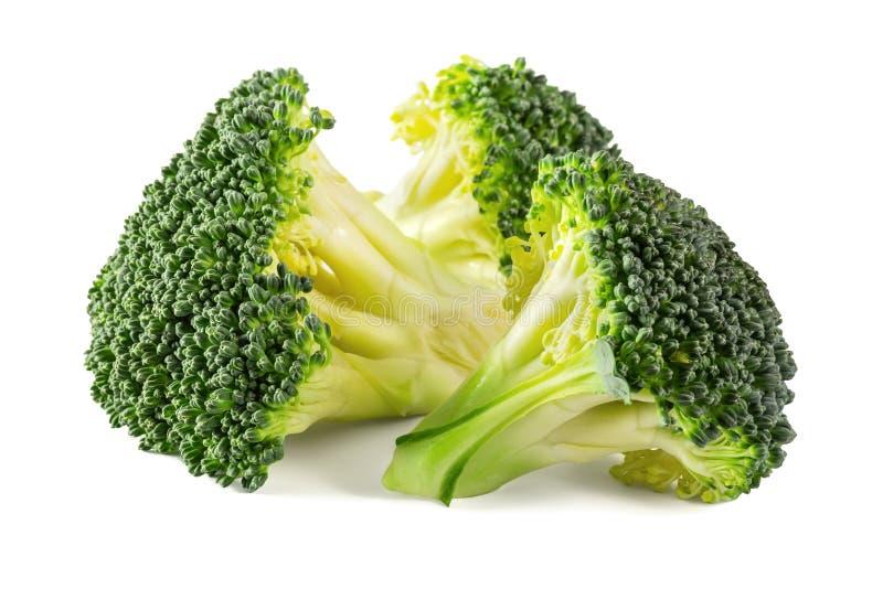 Bróculi verde fresco aislado en el fondo blanco fotos de archivo
