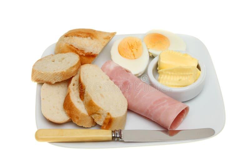 Brödägg och skinka arkivfoto
