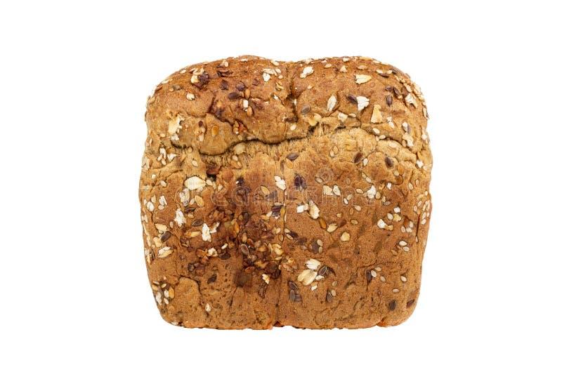 Bröd med linfrö, solrosfrö, pumpafrö, kanderade frukter, rågkli, havreflingor som isoleras på vit arkivbild