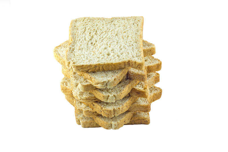 Brödskiva som isoleras på vit bakgrund arkivbild
