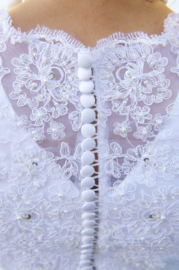 Bröllopsklänningdetalj och brud royaltyfri bild
